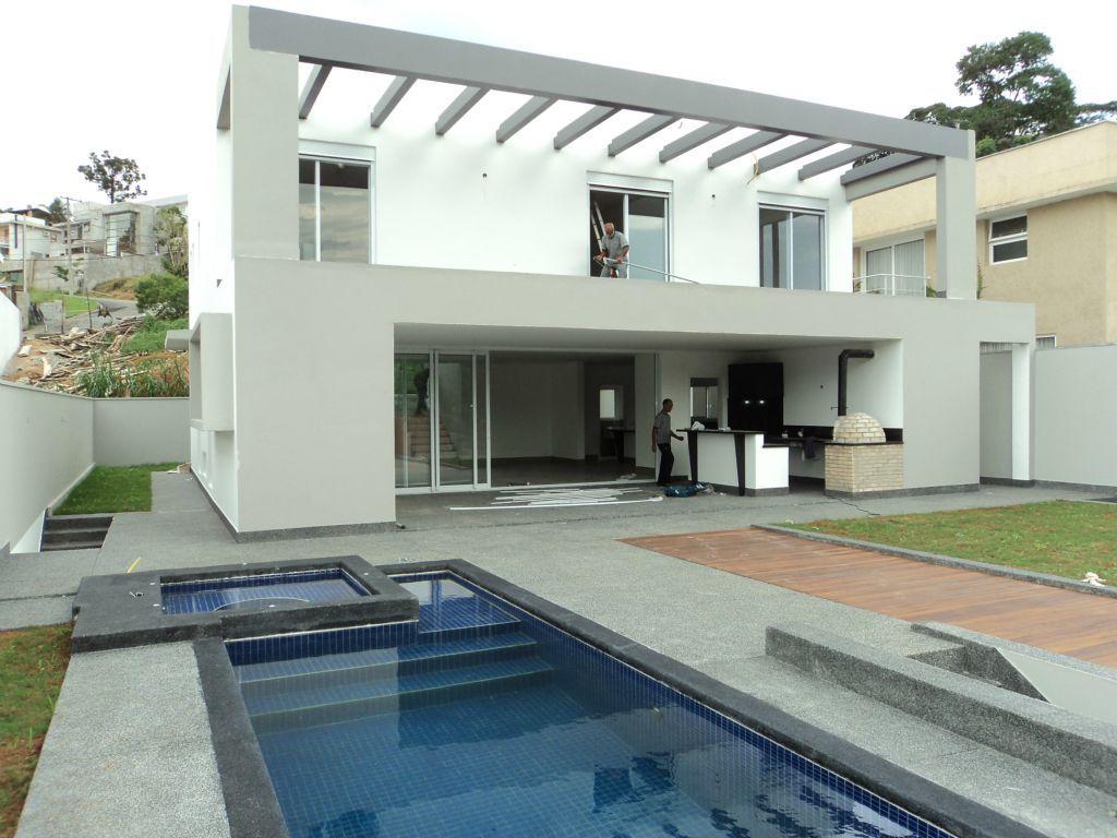 Casa residencial à venda, Golf Village, Carapicuíba. de Terra Granja Viana Imobiliária