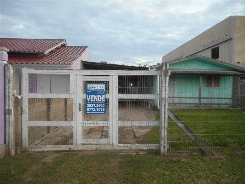 Chalé de madeira em excelente terreno de 400 m², bairro resi de Iniciar Cia Imobiliária.'