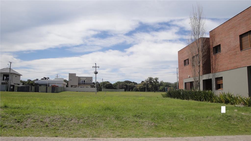 Terreno em condomínio de alto padrão, Tramandaí/RS de Iniciar Cia Imobiliária.'