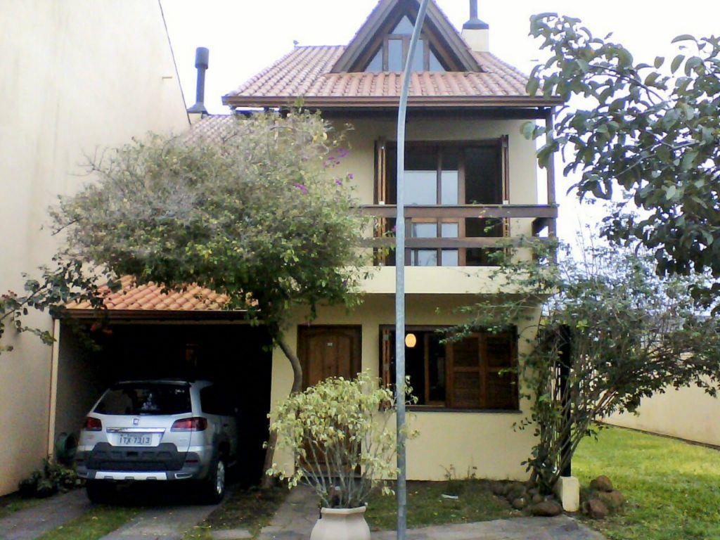 Sobrado de 3 dormitórios à venda em Guarujá, Porto Alegre - RS