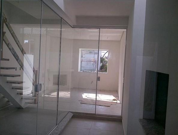 Casa de 2 dormitórios à venda em Guarujá, Porto Alegre - RS