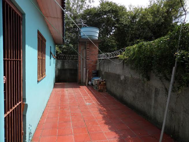 Sobrado de 3 dormitórios em Niterói, Canoas - RS
