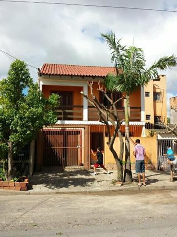 Sobrado de 3 dormitórios em Navegantes, Porto Alegre - RS