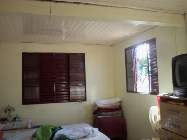 Casa de 5 dormitórios à venda em Juscelino Kubitschek, Santa Maria - RS