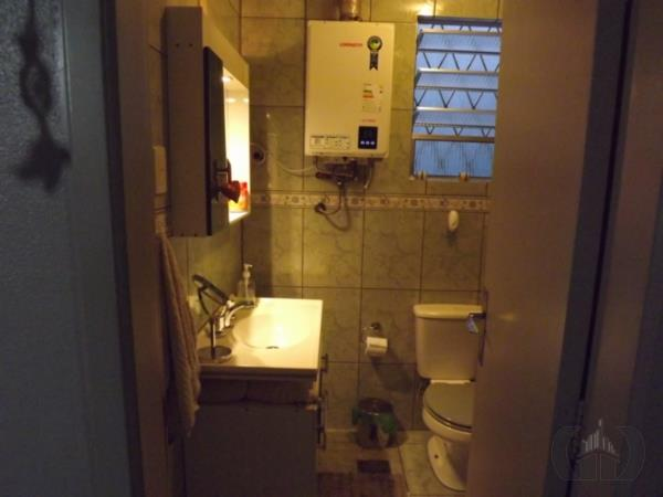 Casa de 4 dormitórios em Rio Branco, Porto Alegre - RS