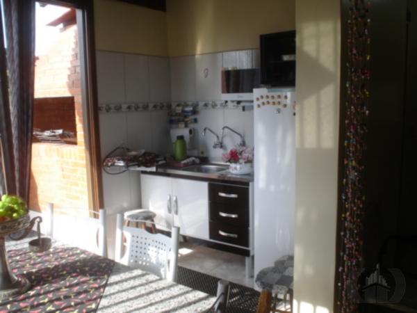 Casa de 2 dormitórios à venda em Menino Deus, Porto Alegre - RS