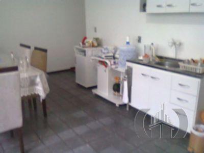 Casa de 4 dormitórios em Azenha, Porto Alegre - RS