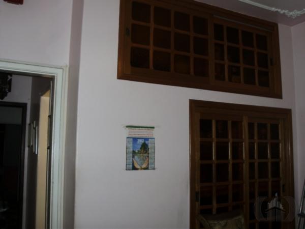 Casa de 6 dormitórios à venda em Menino Deus, Porto Alegre - RS