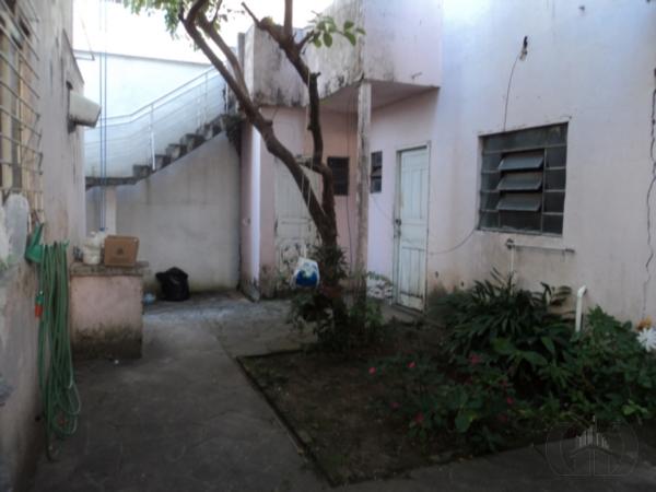Casa de 4 dormitórios à venda em Jardim Botânico, Porto Alegre - RS