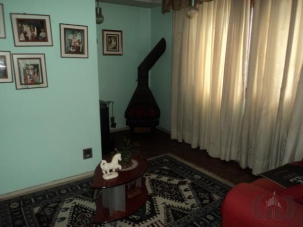 Casa de 4 dormitórios em Jardim Botânico, Porto Alegre - RS