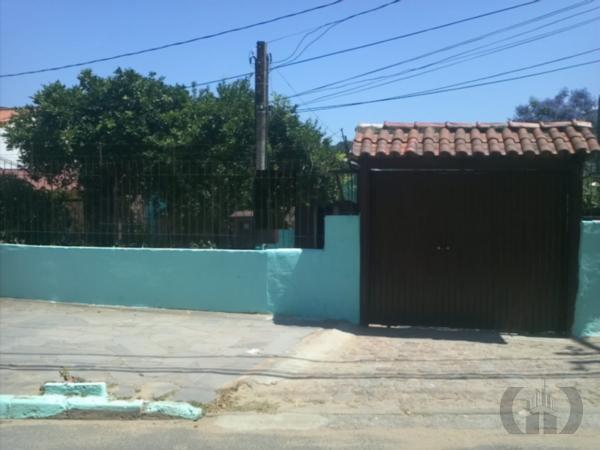 Casa de 6 dormitórios à venda em Vila Nova, Porto Alegre - RS