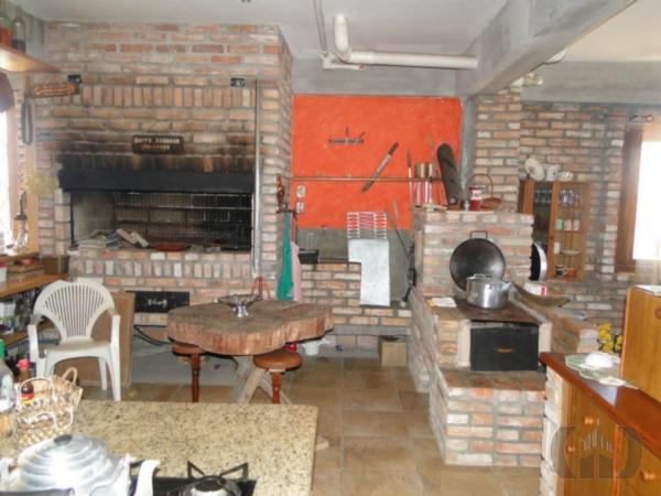 Casa de 4 dormitórios à venda em Mário Quintana, Porto Alegre - RS