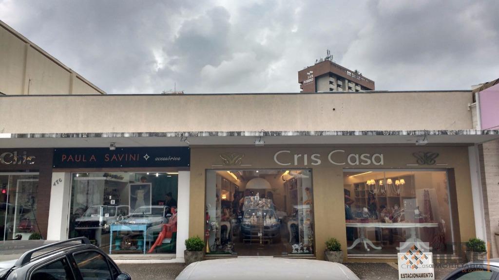4 lojas comerciais, com 4 vagas de garagem, renda mensal de r$ 9.750,00. localizadas em valorizada...