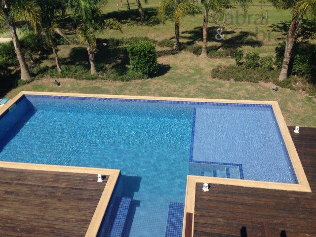 belíssimo sobrado no condomínio costão do golf, em florianópolis, santa catarina, com 04 suítes, sendo 01...