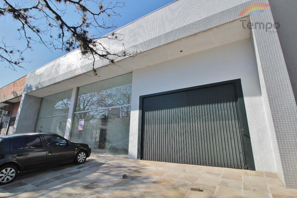loja com vitrine e  estacionamento, localizada em uma das principais avenidas da cidade com fluxo intenso.