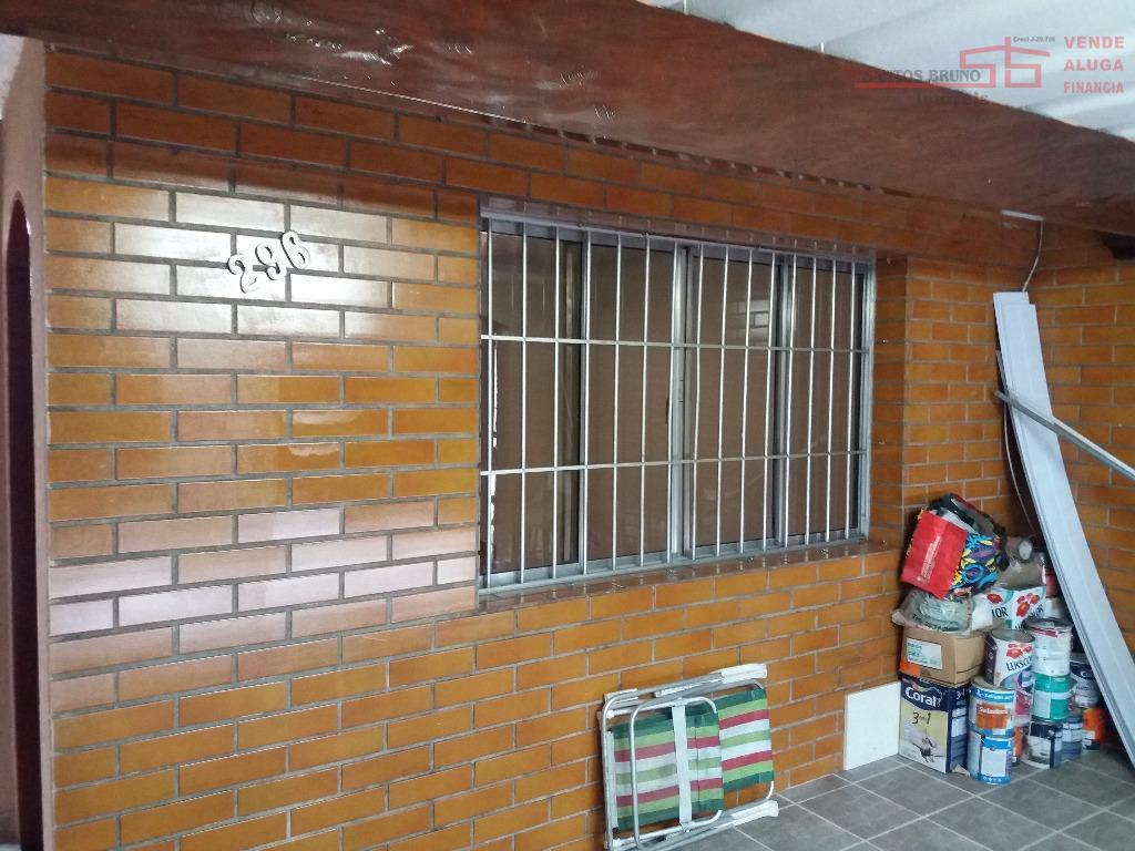 casa linda, com sala ampla e pequeno quintal nos fundos, garagem coberta  com portão 27e17f5887
