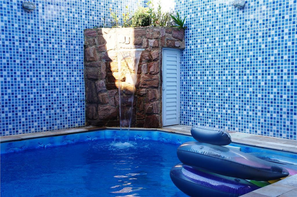 Casa Residencial à venda,  Geminada, 2 Dormitórios, Suíte, Piscina, Churrasqueira, Vila Caiçara, Praia Grande.