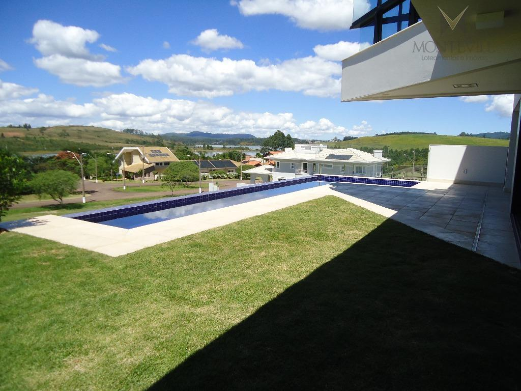 casa de alto padrão, nova, em excelente localização no condomínio, com 525 m² de área construída...