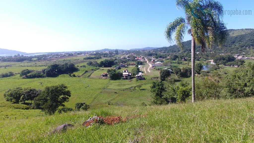 magnífico terreno com quase 5 hectares. linda vista para lagoa e para as montanhas. acesso fácil,...
