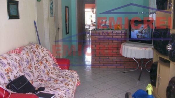 casa de alvenaria com 2 dormitórios, sala 2 ambientes, cozinha, área de serviço, banheiro, pátio e...