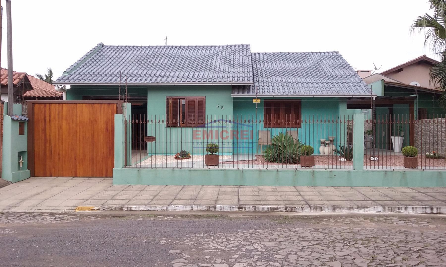 Emicrei vende. Excelente casa 2 dormitórios, garagem, pergolado, frente com grade e portão eletrônico, Scharlau, São Leopoldo.