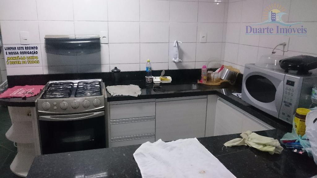 2 dormitórios sendo 1 suíte, sala com dois ambientes, cozinha americana, área de serviço, varanda com...