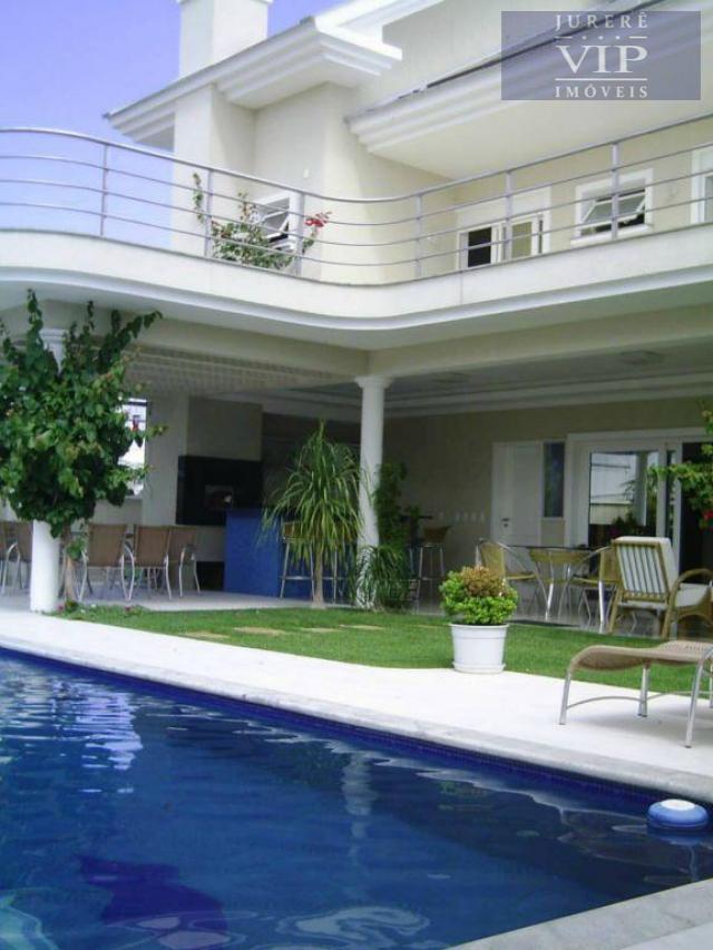 Casa próxima ao mar em Jurerê Internacional, Florianópolis - CA0035.