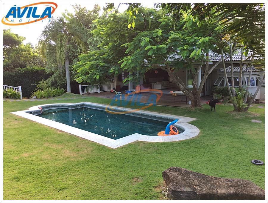 maravilhoso imóvel com 600 m² da área construída em terreno de 1.368 m² em condo fechado...