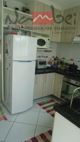 sobrado em condomínio com 02 dormitórios, sala, cozinha, wc, área de serviço e 01 vaga de...