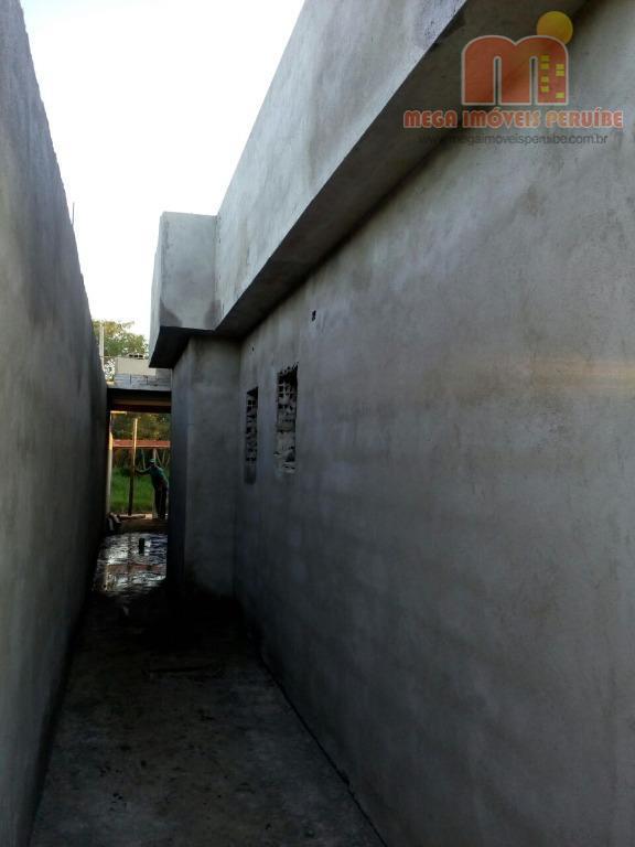 casa em peruíbe com 2 dormitórios (sendo 1 suíte), sala, wc social, cozinha americana, área de...