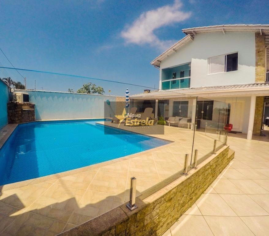 Sobrado  4 dormitórios sendo 3 suítes,6 vagas e garagem, Solemar, Praia Grande.