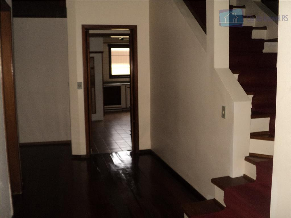 excelente casa com 400m²,sala ampla com lareira,05 dormitorios,05 banheiros,cozinha com armarios,salaõ de festas,piscina,todas as peças amplas,otima...