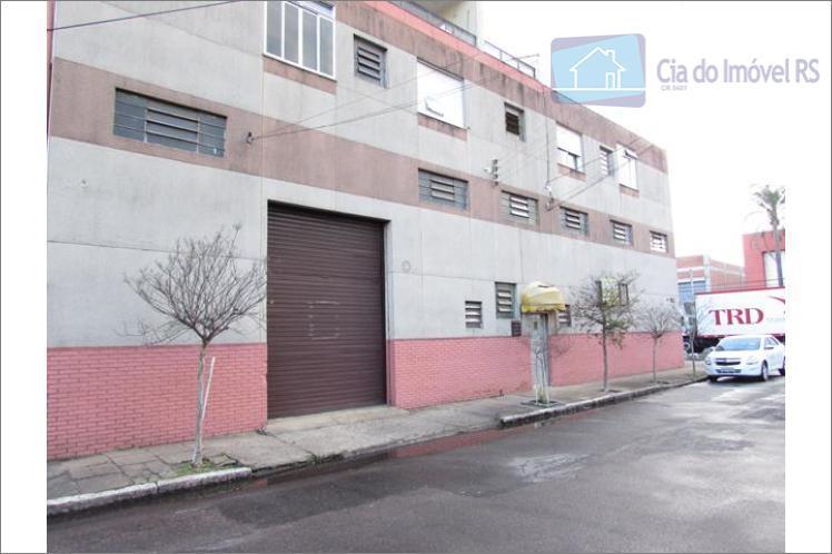 excelente depósito com 02 entradas, aproximadamente 150m², pé direito 7m, piso concreto, 02 banheiros, portão frontal...