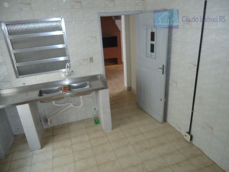 otima casa coml 110m² 04 salas, cozinha, banheiro, lavanderia,fundos com churrasqueira, apto de 01 dormitorio, mais...
