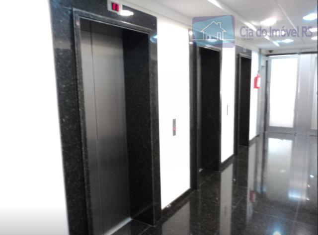 conjunto comercial, salas, 6 box todos cobertos para carro, cozinhas, banheiros, recepção, 3 elevadores, portaria 24...