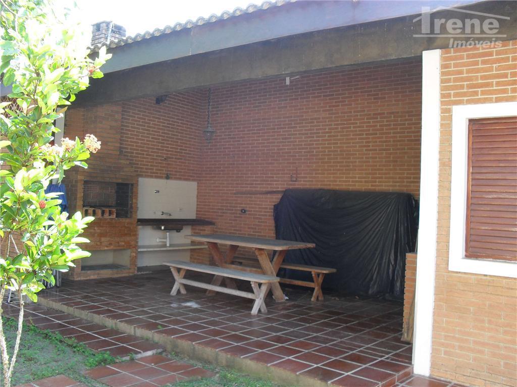 imóvel em ótima localização, com 04 suítes, sala 03 ambientes, cozinha, mezanino, quintal com jardim, piscina...