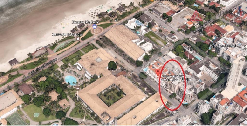 praia da enseada, apto 2 dormitórios, sacada, sala 2 ambientes, 1 vaga coberta em excelente localização...