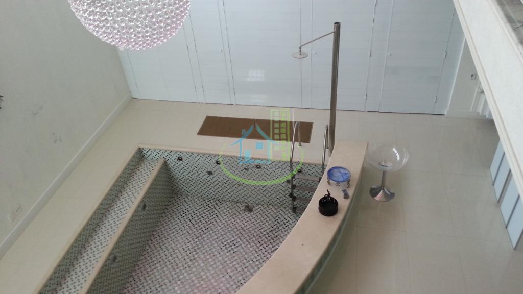 lindo sobrado com 04 dormitórios, sendo 02 suítes, 07 vagas, terraço, quintal ,piscina, sauna,sala de ginastica...