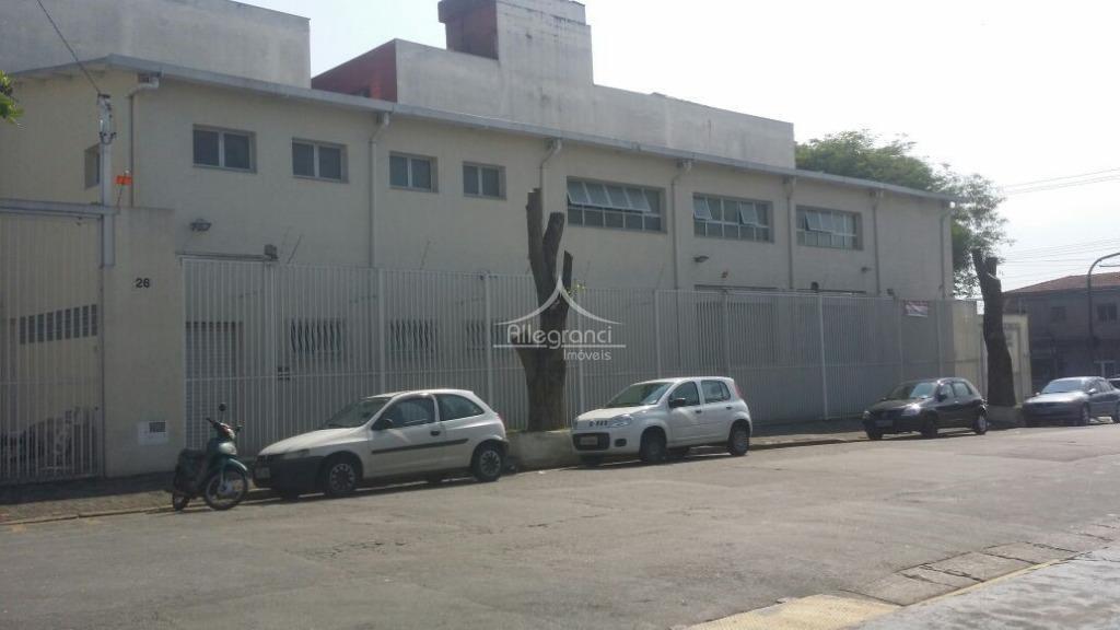 prédio comercial, local movimentado de pedestre e veículos, com muitos comércios ao redor, localizado a quatro...