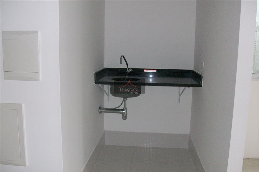 sala 42metros,com banheiro,sacada,2 vagas de garagem.serviços basicos(inclusos na taxa de condominio)