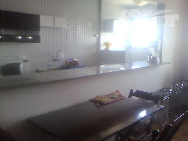 apartamento reformado,cidade ocian/praia grande, área útil 35,00 m² sala, dormitório c/armário e cama, cozinha c/geladeira bosch...