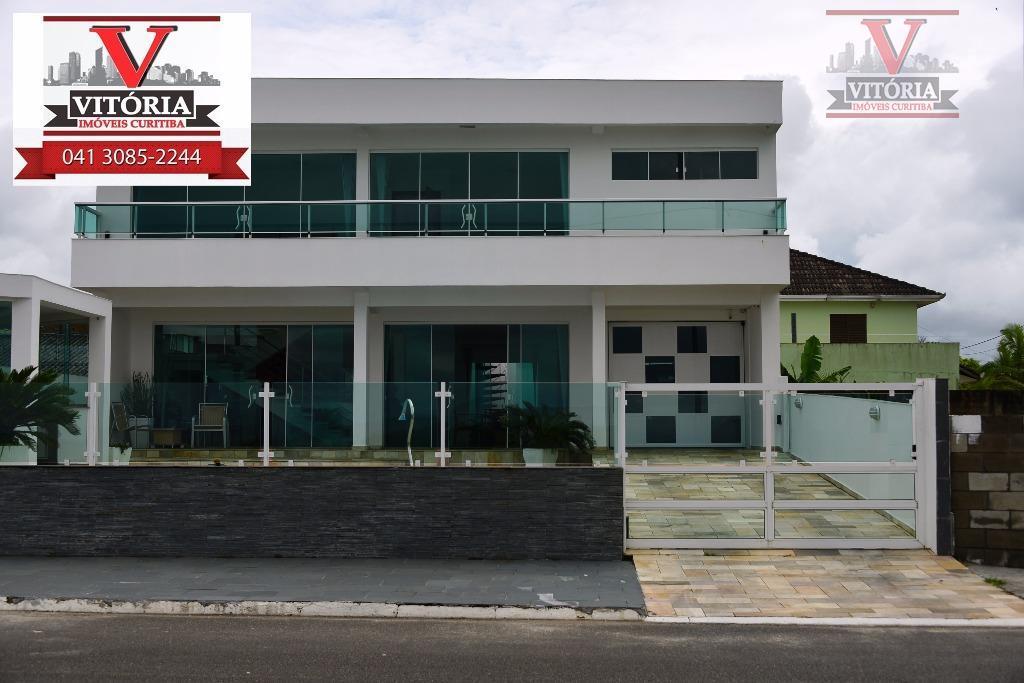 Casa com terreno, de frente para o mar, à venda, Matinhos - SO0274.
