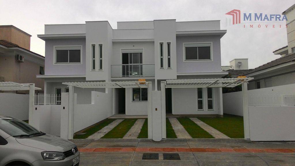dentro de um dos melhores loteamentos do sul da ilha!!! casas geminadas com 03 dormitórios, sendo...