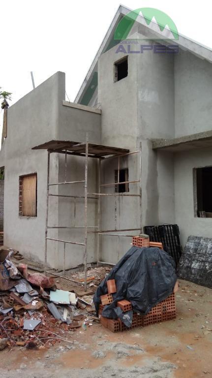 Casa com 3 dormitórios à venda, 82 m² por R$ 298.000