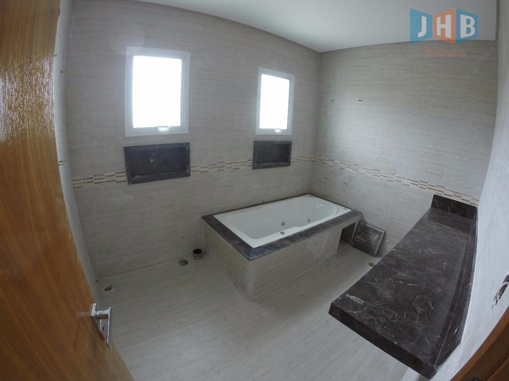 4 suítes sendo 1 closet e 1 hidro, sala 3 ambientes, sacada, escritório, lavabo, wc social,...