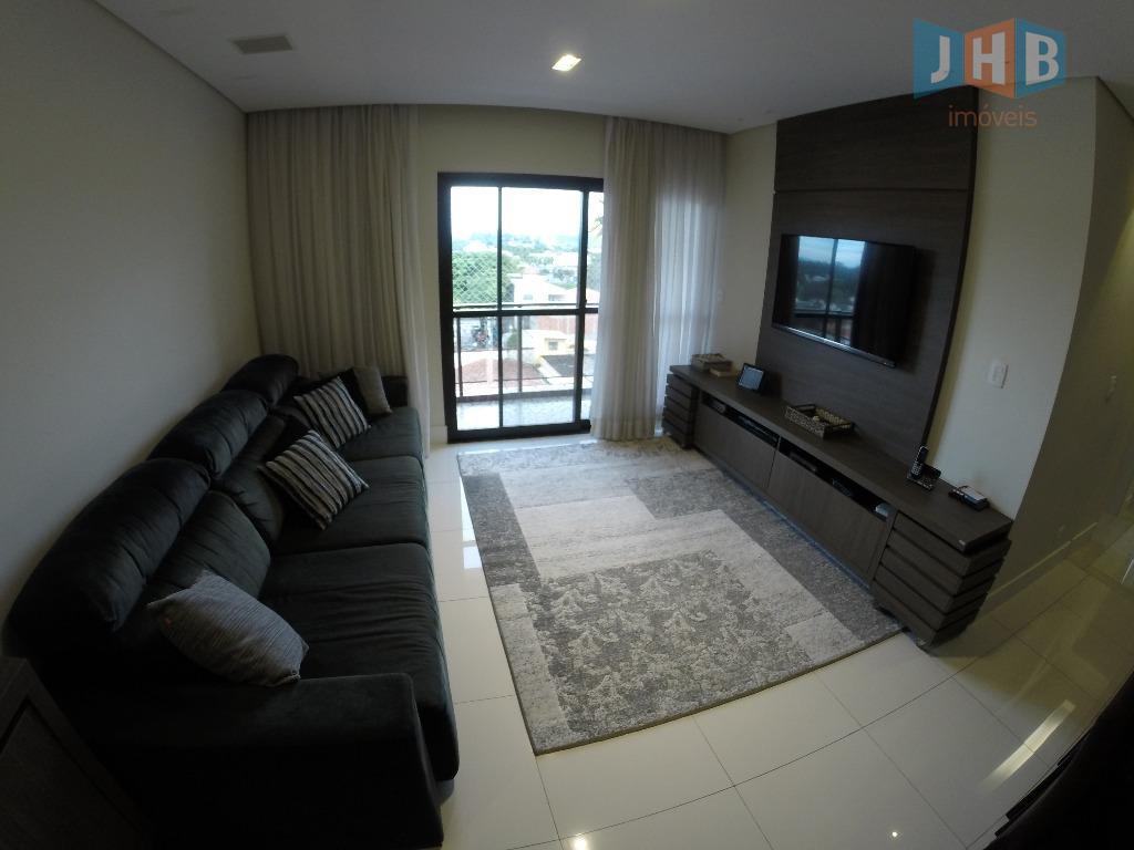 3 dormitórios com armários sendo 1 suíte, sala 2 ambientes com armários, sacada, wc social com...