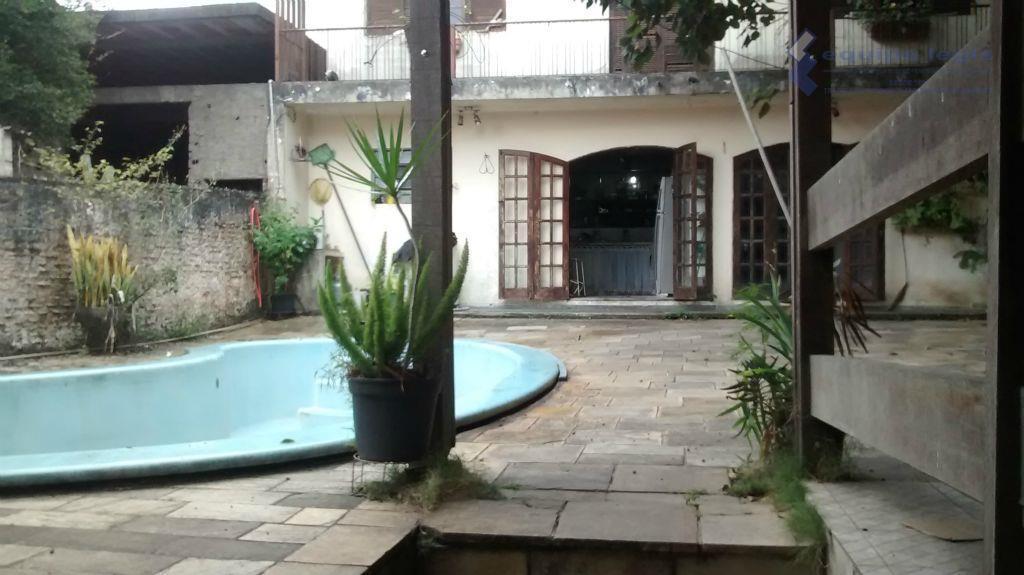 Terreno com 02 casas residenciais à venda, Itaquera, São Paulo.