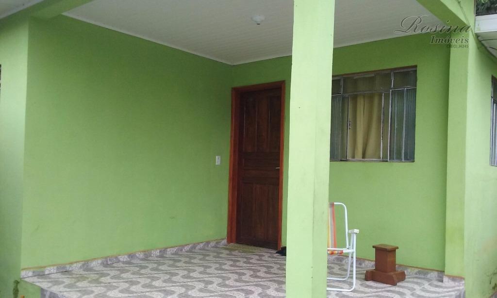 ótimo terreno comercial - com uma casa de madeira de 50m² contendo 2 quartos , sala,...
