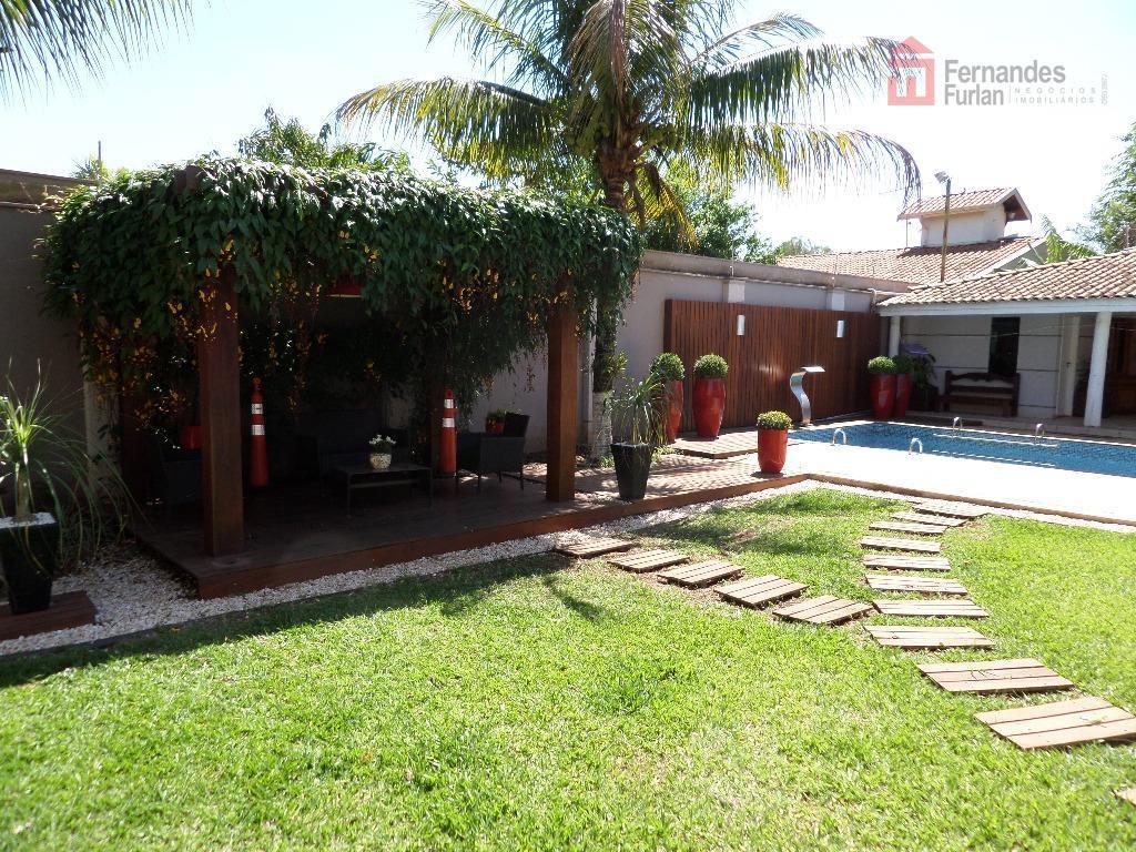 casa alto padrão , terreno plano, com lago ornamental, 3 salas amplas, bar, amplo mezanino com...