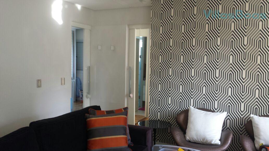 2 dormitórios sendo 1 suite sala estendida cozinha com armários lavabo 2 vagas de garagemobs: ela...
